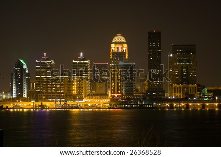 Downtown Louisville, KY on a clear night with the reflection of the city in the river - stock photo