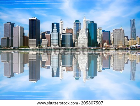 Downtown (Lower) Manhattan's Financial District as seen from Brooklyn at the Brooklyn Bridge Park.   - stock photo