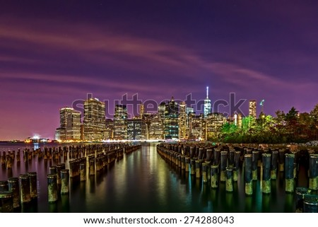 Downtown Manhattan skyline at night from across East River in Brooklyn, New York, USA - stock photo