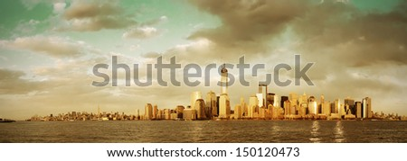 Downtown Manhattan skyline in old yellow tone over Hudson River in New York City - stock photo