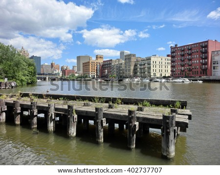 Downtown Milwaukee with dock across Kinnickinnic river - landscape color photo - stock photo