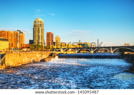 Downtown Minneapolis, Minnesota at night time as seen from the Stone Arch Bridge - stock photo