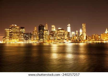 Downtown NYC skyline at night  - stock photo