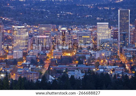 Downtown Portland Oregon city lights blue hour. - stock photo