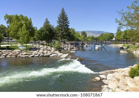 Downtown Reno public park and river with surrounding mountains. - stock photo