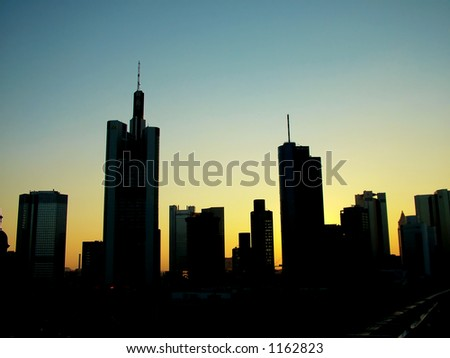 Downtown skyline at sunset - stock photo