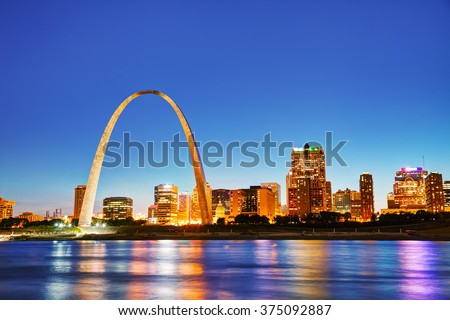 Downtown St Louis, MO with the Old Courthouse and the Gateway Arch at sunset - stock photo