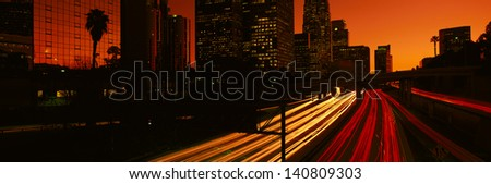 Downtown traffic at night, Los Angeles, California - stock photo