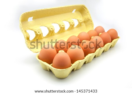 dozen eggs in a cardboard box - stock photo