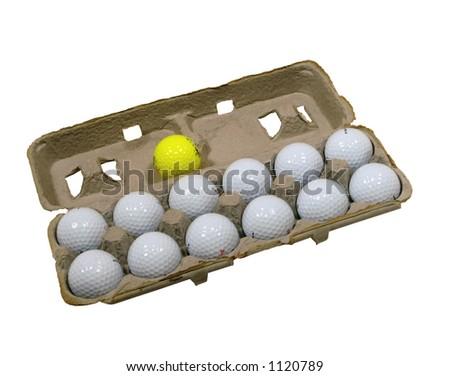 Dozen golf balls with one yellow ball in egg carton - stock photo
