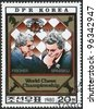 DPR KOREA - CIRCA 1980: A stamp printed in DPR KOREA shows Fischer and Spasskij playing chess. World Chess Championship, circa 1980 - stock photo
