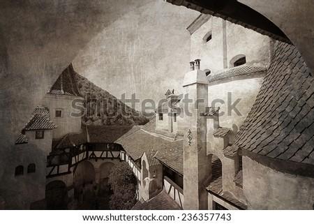 Dracula's Castle .The medieval Bran Castle,view of backyard.Transylvania,Romania.Vintage texture applied. - stock photo