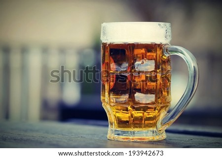 draft beer by the glass. - stock photo