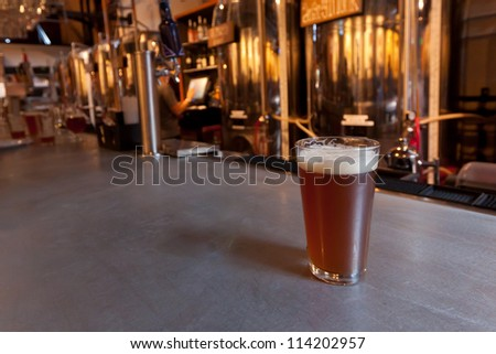 Draft Beer on Bar at Brew Pub - with room for text - stock photo