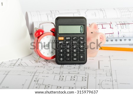 Drafts with piggy bank, calculator and yellow pencil, close up view - stock photo