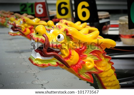 Dragon Boats at the dock. - stock photo