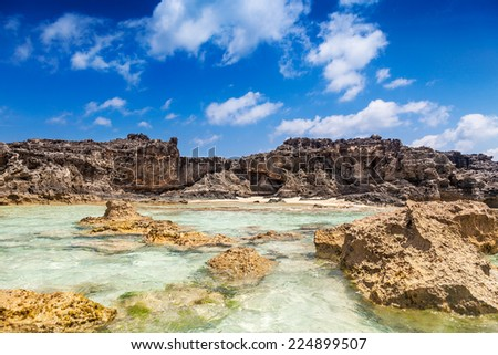 Dragon Cay at low tide with the rocks mostly exposed, Mudjin Harbor, Middle Caicos - stock photo