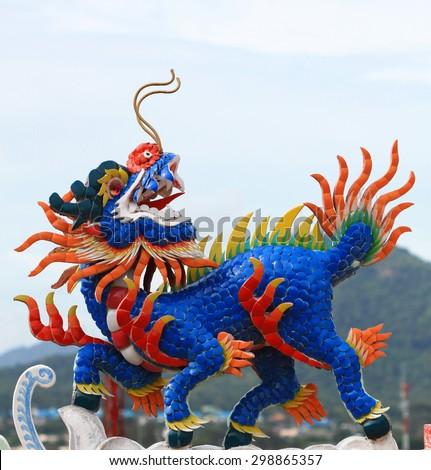 Dragon head unicorn on temple roof - stock photo