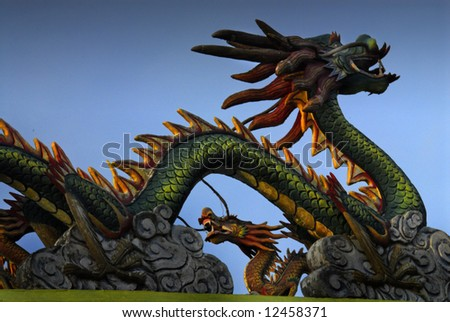 Dragon on oriental temple roof - stock photo