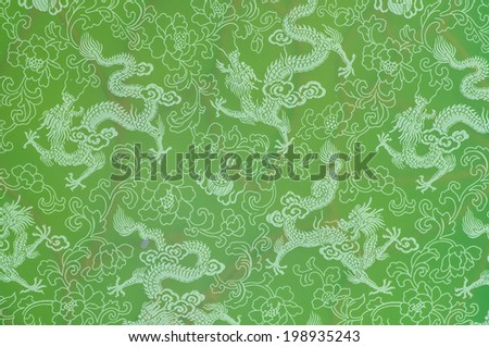 dragon pattern on chinese temple door - stock photo