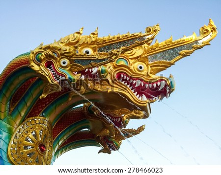 Dragon sculpture fountain in the traditional Thai style. - stock photo