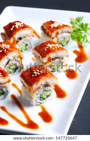 DRAGON SPECIAL MAKI : Grilled Eel ,Kaiware Sprouts,Cucumber and Sesame maki by Fresh Avocado with Special Soy Sauce.  - stock photo