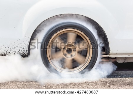 Dragster Car Burn Out Rear Tyre With Smoke - stock photo