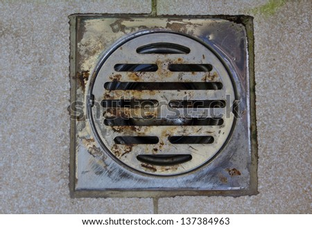 Drain holes on the brown tile. - stock photo