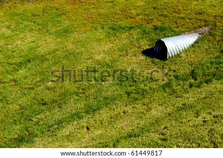 Drainage Basin Covered in Grass - stock photo