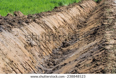 Drainage ditch Unfinished in countryside - stock photo