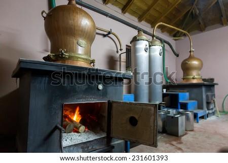 DRAMA, GREECE - NOVEMBER 15,2014: During traditional distillation of alcohol and production of homemade tsipouro/raki - stock photo