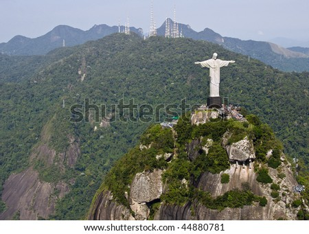Dramatic aerial view of Christ The Redeemer Monument perched on Corcovado Mountain - stock photo