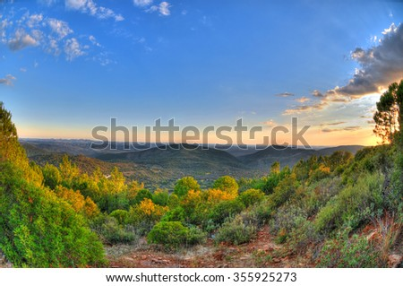 Dramatic amazing sunset in HDR on the mountains of Huelva province in Spain near Alajar. Pastoral picture.  - stock photo