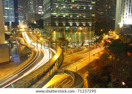 Dramatic and busy traffic in Hong Kong at night - stock photo