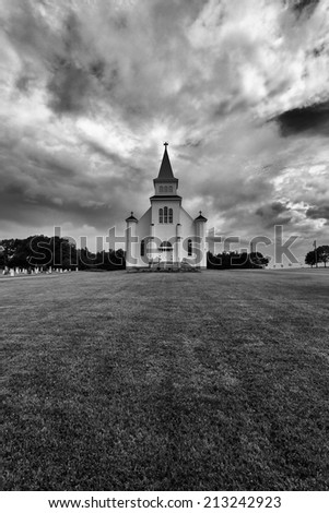 Dramatic and Scary Black and White of Church and Cemetery St Peters Prince Edward Island Canada - stock photo
