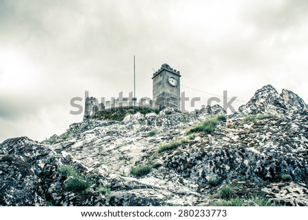 Dramatic and scenic look of the Medieval castle on the rock hill - Folgosinho Castle in Portugal, Europe - stock photo