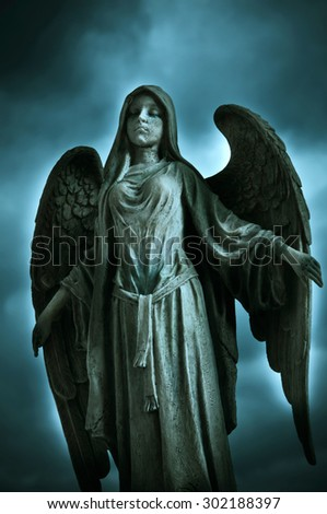dramatic angel statue - stock photo