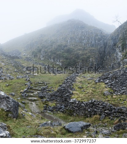 Dramatic Autumn Fall landscape of rocky hills in Yorkshire Dales - stock photo