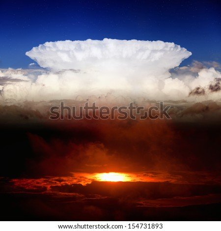 Dramatic background - dark red sunset, white clouds, blue sky, heaven and hell - stock photo