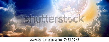 Dramatic background - impressive abstract sunset with planet in cloudy sky - stock photo