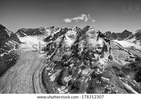 Dramatic Black and White Landscape of Denali or Mt Mckinley and Glacier from Airplane Alaska - stock photo