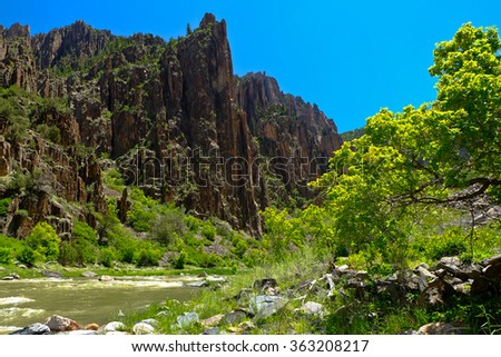 Dramatic Cliffs of the Black Canyon Of the Gunnison River.  Black Canyon Of the Gunnison National Park, Colorado - stock photo
