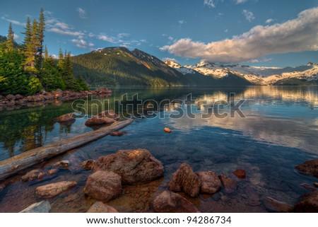 Dramatic cloud above blue mountain lake - stock photo