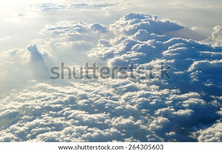 Dramatic Cloud formation:stormy clouds over a clean blue sky giving a mysterious grungy spooky look ideal for air travel background designs taken from a airplane on a business trip to New Delhi - stock photo