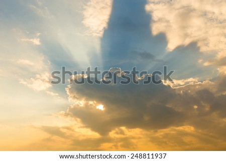 dramatic cloud with sunbeams in the sky - stock photo
