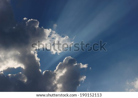 Dramatic clouds and sunbeams at a summer sky - stock photo