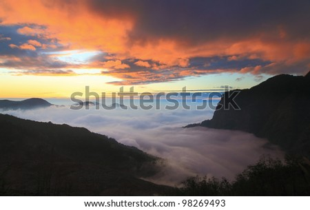 dramatic Clouds rolling over mountains at sunset shot in taiwan formosa asia - stock photo