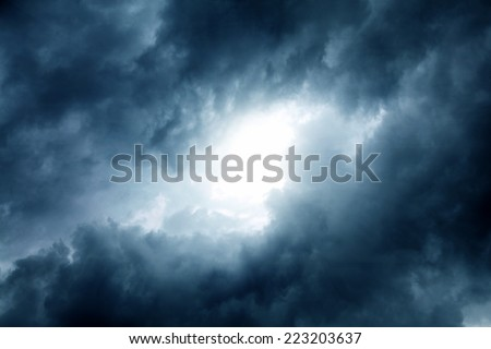 Dramatic Cloudscape Area with the Light in the centre - stock photo