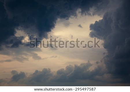 Dramatic Cloudscape Background. Stormy Clouds in Dark Sky. Toned Photo with Copy Space. - stock photo
