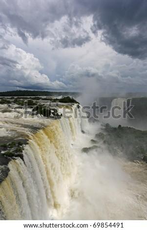 Dramatic cloudscape over gigantic waterfalls of Iguazu - stock photo